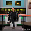Adam sits in Captain Kirk's command chair in the recreated bridge.