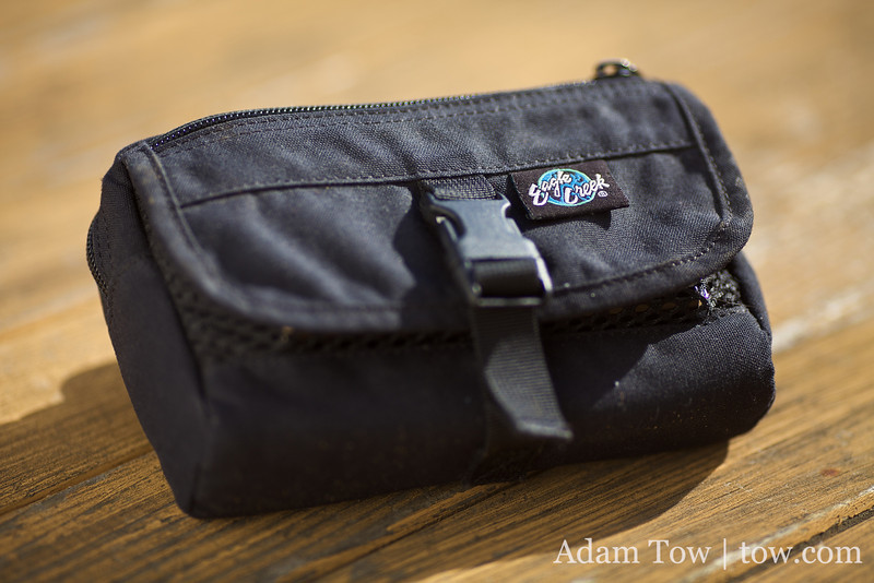 The WiFi/EVDO router, EVDO USB modem, and battery all fit in this small Eagle Creek waist belt bag.