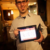 Adam holds up the Autumn Gem for the iPad application.