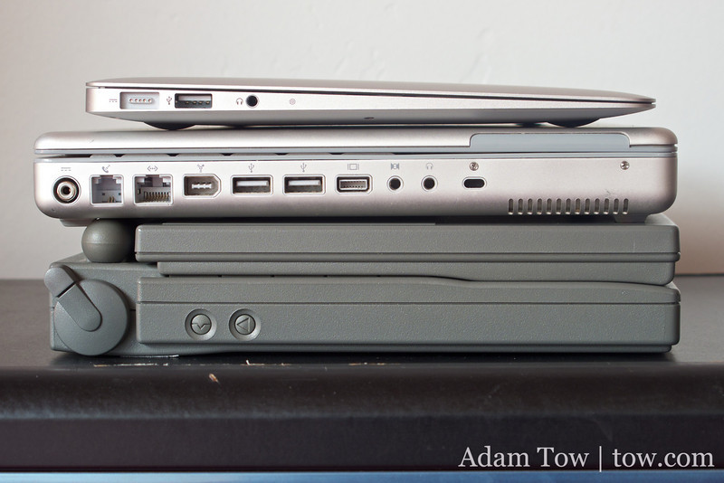 The new 11.6-inch MacBook Air on top of the original 12-inch PowerBook G4 and the PowerBook 100.