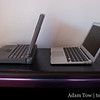 Side by side, the PowerBook 100 and the 11.6-inch MacBook Air.