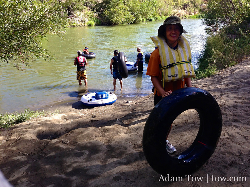 At the midpoint of our inner tubing adventure down Cache Creek. Rae was ready to call it quits, but she made it to the end.