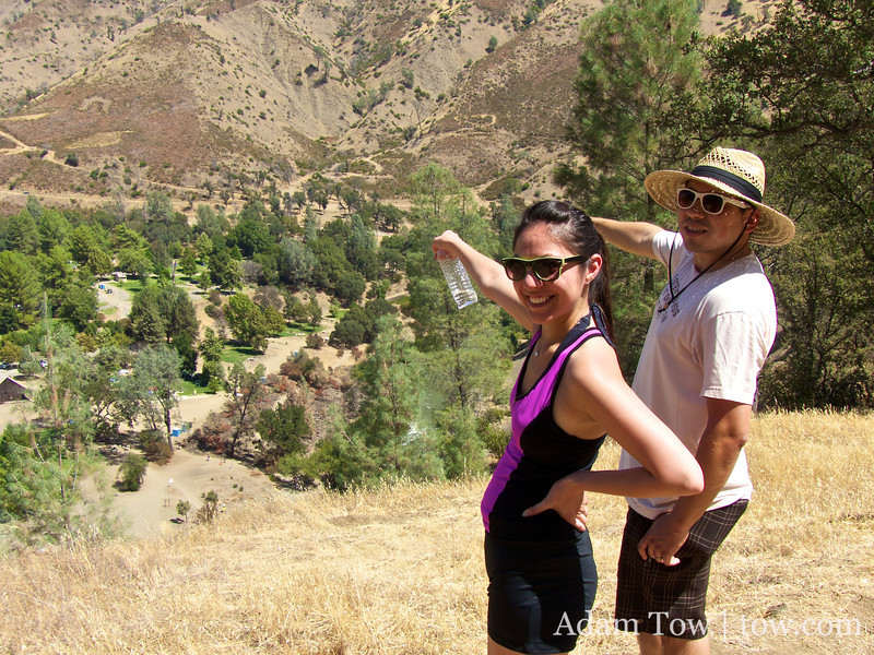 Cheryl and Osvaldo point to their campsite.