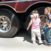 Cameron Voinovich, 4, right, and his sister, Madison, 2, of Westerville get a close-up look at the tires on a fire truck during the Touch a Truck event at the Powell Municipal Building onFriday.