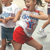 Jenna Wurzel, 6, shows off her moves while dancing at the Fremont St. Joseph cheerleading clinic on Monday.<br /> Photo Ben French