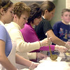 (L-R) Adrianna Trumpower, Janet Celek, Rose Day, Angel Trumpower and Jake Floriana serve up meals at Sacred Heart Church on Thanksgiving.<br /> Photo ben French