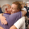 (L-R) Fremont Athletic Director Art Bucci and Fremont Board of Education Member Linda Hershey embrace at the Sandusky County Board of Education last night after hearing the results.<br /> Photo Ben French