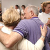 (L-R) Fremont Athletic Director Art Bucci and his wife, Lisa, embrace at the Sandusky County Board of Education last night after hearing the results.<br /> Photo Ben French