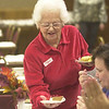 Mildred Hofelich, 92, serves up a couple of pies to hungry community members at the Fremont Thanksgiving dinner at the VFW hall.<br /> Photo ben French