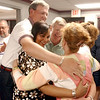 (L-R) Fremont Board of Education members Dan Lease, Tamara Damschroder, Jim Fails, Linda Hershey and Cyndi Wise give a group hug at the Sandusky County Board of Education last night after hearing the results.<br /> Photo Ben French