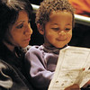Tara Woodford of Dublin and her son, Brock Woodford, 3, look over the program during the Dublin Community Rememberance celebration of Dr. Martin Luther King, Jr. at Dublin Jerome High School on Monday.