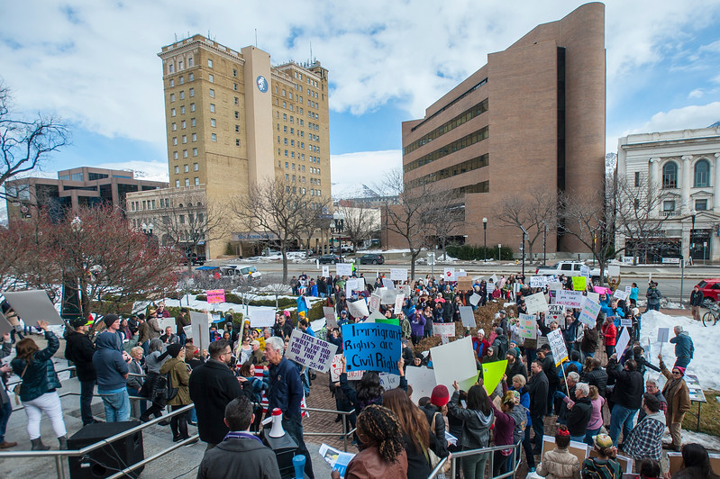 A crowd marches down 25th Street to protest the newly elected president Donald Trump. The group gathers at the front steps of the Ogden Municipal Building in Ogden on Saturday February 4, 2017.