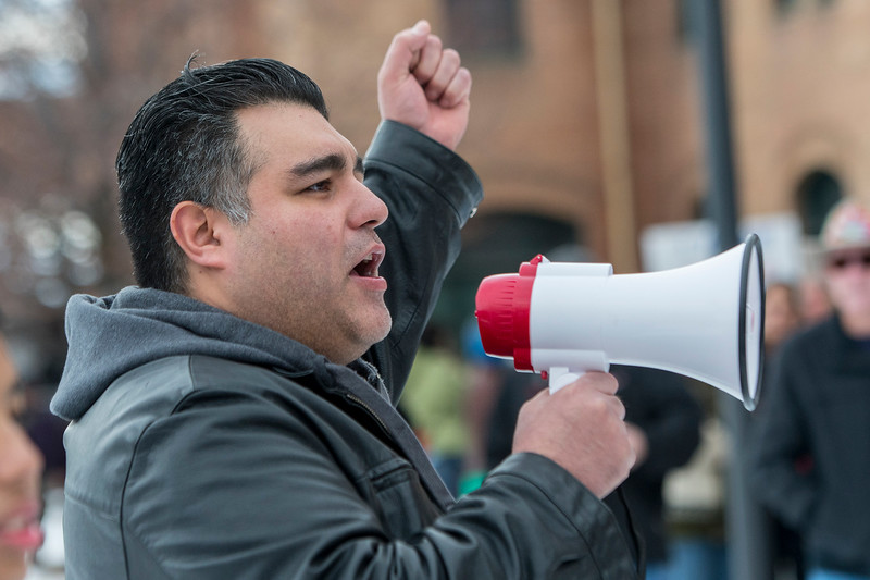 Communications and Outreach coordinator Jesus Lopez Jr gives a anti-Trump speech at the Union Station in Ogden. The plan is to protest and march down Historic 25th Street to the Ogden Municipal Building where a crowd gathers on Saturday February 4, 2017.