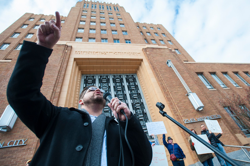 John Miles of Weber County Party of democrats organizes a anti-Trump march down Historic 25th Street. The group protests the unfair treatment of immigrants and women. In Ogden on Saturday February 4, 2017.