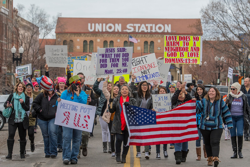 Hilda Brown (middle left) and Starly Thoorsell (middle right) hold a flag lead the group at the anti-Trump march down 25th Street in Ogden on Saturday February 4, 2017