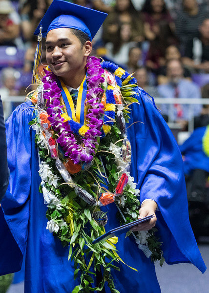 Senior class officer president Kanakanui Uli'i shakes the hands of the Bonneville High's administration during the graduation ceremony at the Dee Events Center in Ogden on May 22, 2017.