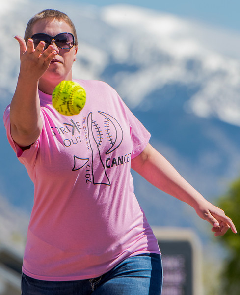 Chantel Heim throws out the first pitch at Weber High School on Monday May 1, 2017. Chantel recently had a double mastectomy. The school had a pink out to help pay for her treatment.