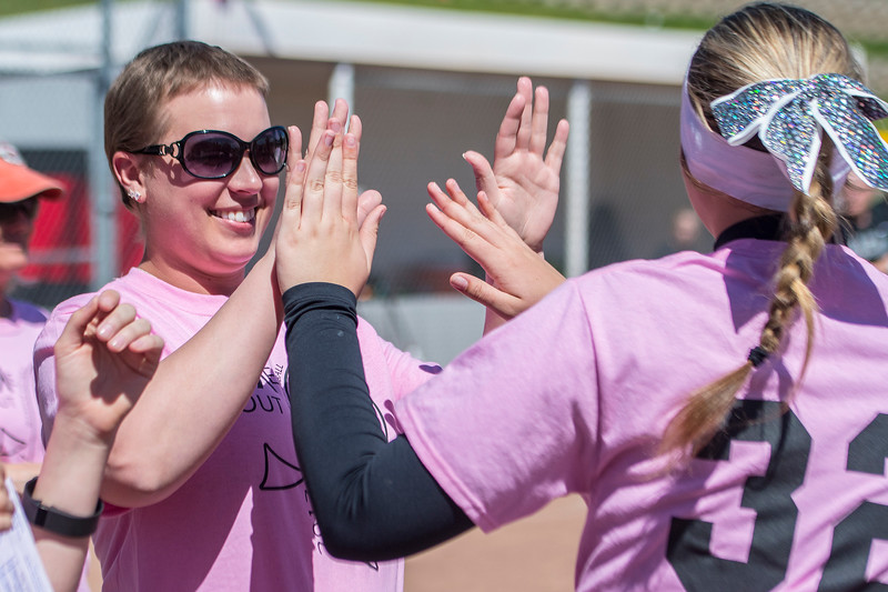 Chantel Heim high fives the Weber softball team before the they take the field  at Weber High School on Monday May 1, 2017. The School put on a pink out where they are selling shirts to help pay for her treatment. Chantel recently had a double mastectomy.