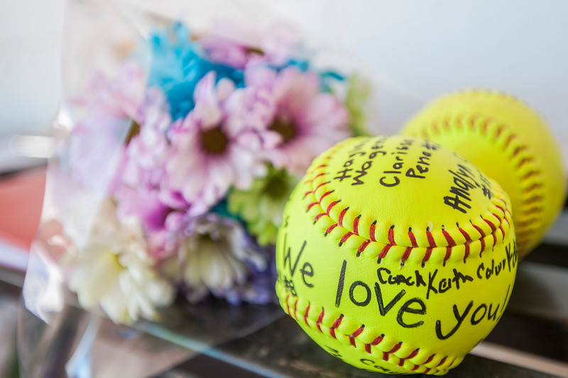 Weber's Softball team signs a ball for Chantel Heim who recently had a double mastectomy. She threw out the first pitch at Weber High School on Monday May 1, 2017.'