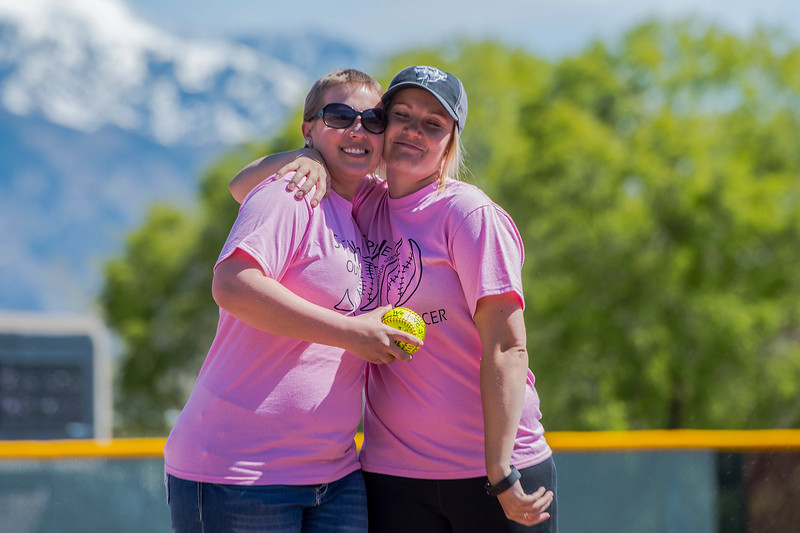 Weber's Softball coach Kylee Colvin (right) hugs Chantel Heim before the start of the game at Weber High School on Monday May 1, 2017. The school had a pink out to help pay for her treatment. Chantel recently had a double mastectomy.
