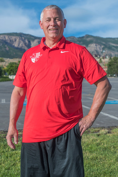 Coach of the Year Jan Swift of Weber High School gets his portrait taken in Pleasant View on June 15, 2017.