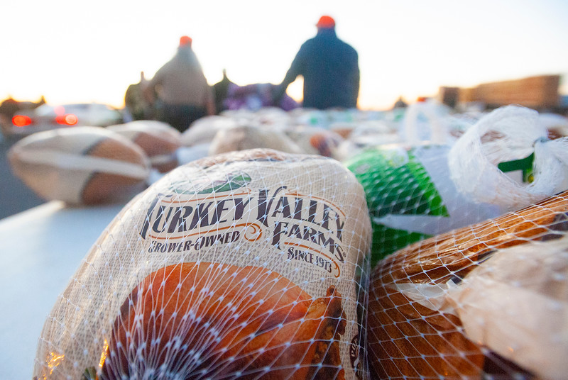 Weber County Sheriff's Office help donate food to families in need at the Weber County Fairgrounds in Ogden, on November 24, 2020.