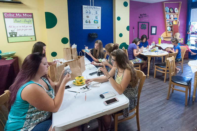 A group of people do arts and crafts at the Color Me Mine store on 25th Street during the First Friday Art Stroll in Ogden on Friday August 4, 2017.