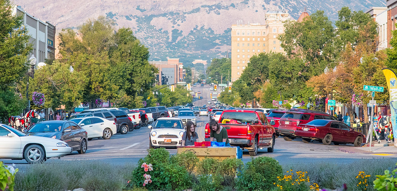 People walk up and down 25th street for the First Friday Art Stroll in Ogden on Friday August 4, 2017.
