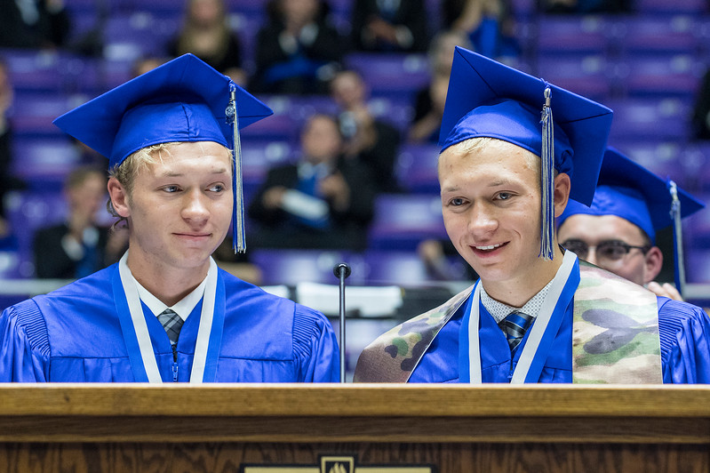 Twin brothers Brandon and Conley Lunford conduct the changing of the tassels during Fremont High Schools  graduation ceremony on Monday at the Dee Events Center in Ogden on May 22, 2017.