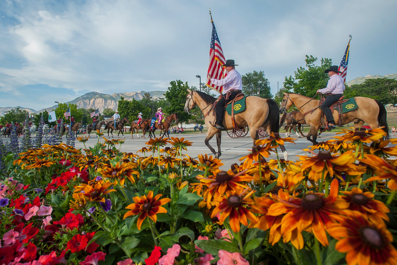 Members of the Weber County Sheriff's Mounted Posse  ride and wave to the crowd during the Horse and Hitch Parade In Ogden on July 17, 2017.