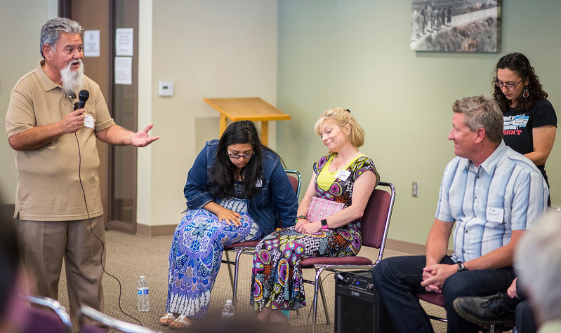 Jesse Garcia has a word with Ogden City officials about talk in the Trump administration against the latino population. At St Joseph Catholic Church Education Center in Ogden on June 17, 2017.