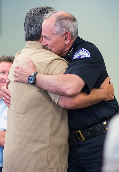 "Jesse Garcia and Ogden Police Chief Steven ""Randy"" Watt embrace during the broader Latino and immigrant community meeting, to reassure group members that local officials aren't targeting them. At St Joseph Catholic Church Education Center in Ogden on June 17, 2017."