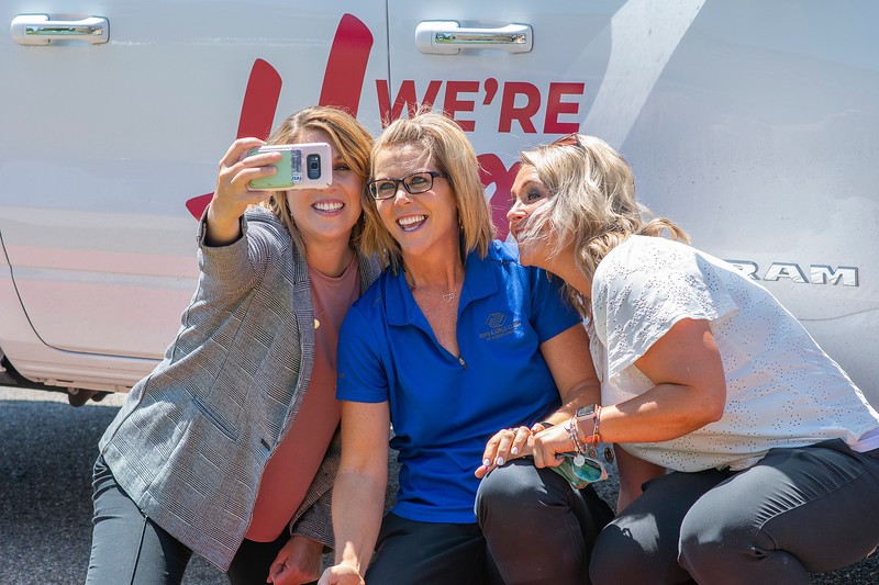 Savannah Cantwell (left) ,Shelly Smith and Emily Oyler (right) take a selfie in front of the Ken Garff truck. Ken Garff of Riverdale made a donation to Boys & Girls Club's Family Outreach Program in Roy, On July 7, 2020.