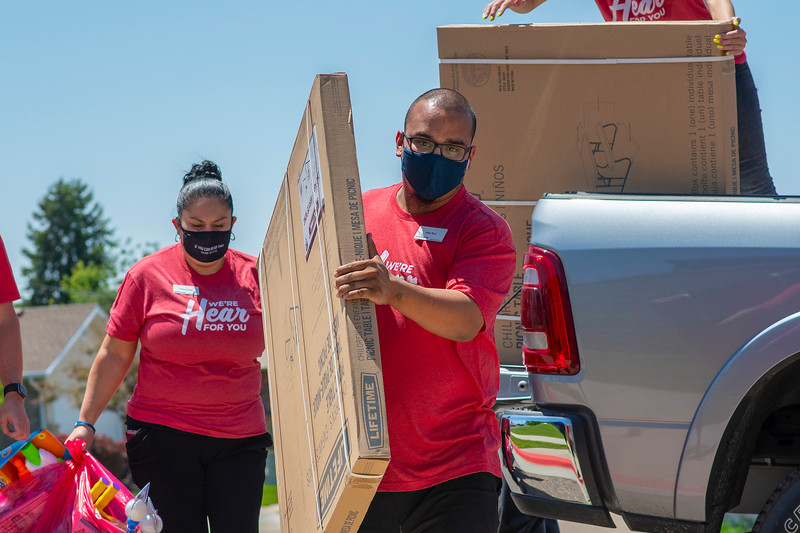 Alex Rulz and Yenia offload donations. Ken Garff of Riverdale made a donation to Boys & Girls Club's Family Outreach Program in Roy, On July 7, 2020.