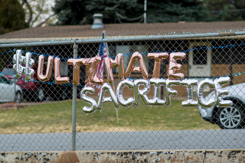 The hashtag Ultimate Sacrifice balloon words are placed on the perimeter fence of the  Ben Lomond Cemetery in North Ogden. Maj. Brent R. Taylor Funeral service took place on Saturday, Nov 17, 2018.
