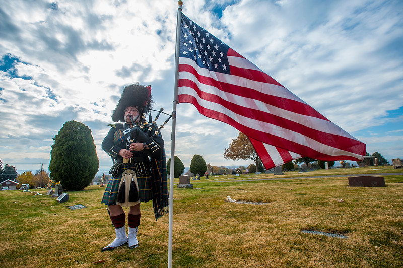 Eric Evenhuis plays the bagpipes during Maj. Brent R. Taylor funeral,on Saturday, Nov 17, 2018, at the Ben Lomond Cemetery in North Ogden.