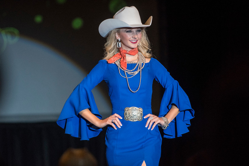 2018 Miss Rodeo Utah hopeful Kassadee Jo Jones walks down the runway in a blue dress, on Saturday July 22, 2017, at the Ogden Eccles Conference Center.