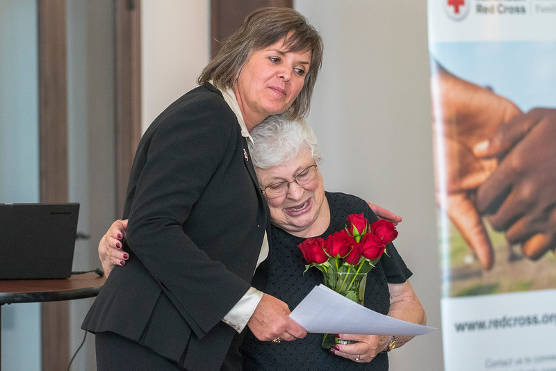 American Red Cross Executive Director Madeline McDonald presents Liz Tacado with the biggest award of the evening. Liz was recognized for her 45 years of active service. The annual celebration was held at the Arbor Lodge in Eden on June 15, 2017.