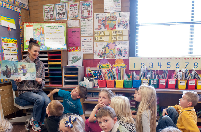 1st grade teacher Kristie Larson reads to her class with the schools new PA system. Its a wearable mic that transmits her voice to a PA system and makes class time more interactive. The units are also able to play music and dvd audio. At Lomond View Elementary in North Ogden on February 2, 2015.
