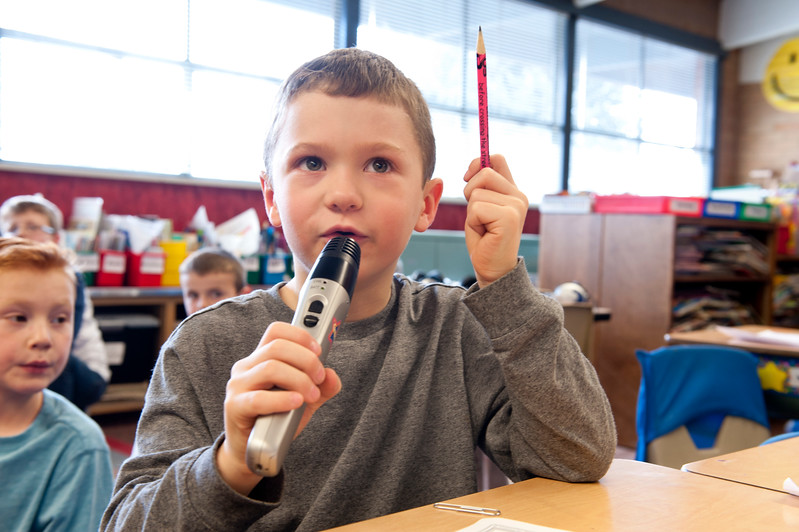 1st grade teacher Kristie Larson's student Luke deminstrates the student accessory for the schools new PA system. At Lomond View Elementary in North Ogden on February 2, 2015.