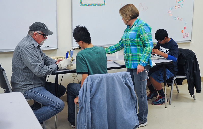 Barbara and Terry Wesley are teaching the Boys and Girls Club students how to work with glass. They are making jewelry and finishing the projects at the club. On December 12 2013.(Brian Wolfer Special to the Standard-Examiner)