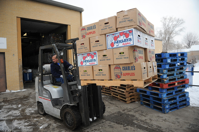 Efren Bravo unloads a truck full of fresh produce to the Catholic Community Services Food Bank in Ogden. On December 13 2013.(Brian Wolfer Special to the Standard-Examiner)