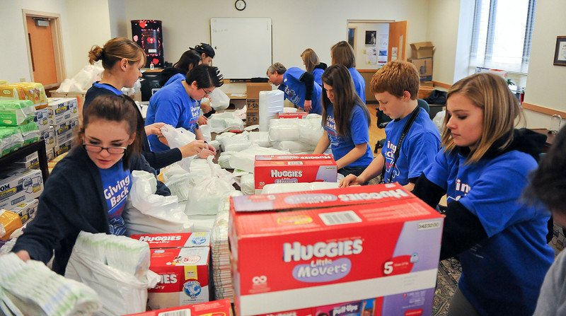 Ogden Prep Academy prepares boxes of diapers for needy families. At the Catholic Community Services Food Bank in Ogden. On December 13 2013.(Brian Wolfer Special to the Standard-Examiner)