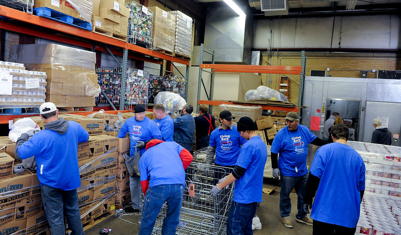 Volunteers put in a days work to help feed the needy. At the Catholic Community Services Food Bank in Ogden. On December 13 2013.(Brian Wolfer Special to the Standard-Examiner)
