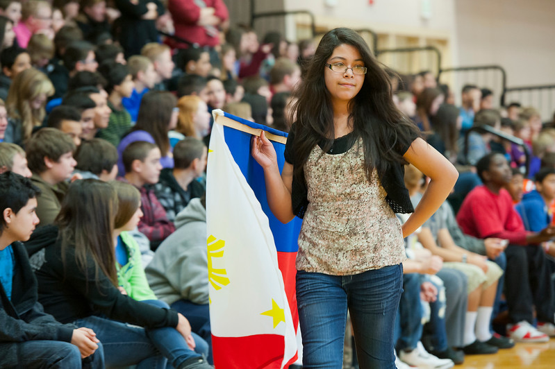 North Davis Junior High student proudly carries a filipino flag during the international flag ceremony at the start diversity assembly. In Clearfield. On January 22 2014. (Brian Wolfer Special to the Standard-Examiner)