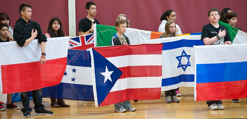 On Wednesday North Davis Junior High students do a international flag ceremony at the start diversity assembly. In Clearfield. On January 22 2014. (Brian Wolfer Special to the Standard-Examiner)