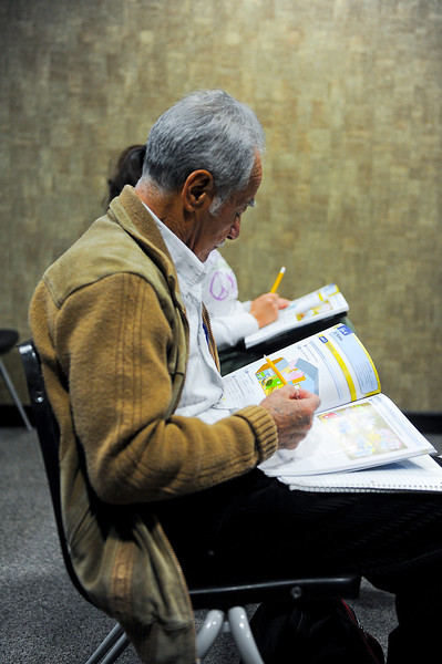 Enrique studys his english book during free english workshop. At the Weber County Library in Ogden. On November 30 2013. (Brian Wolfer Special to the Standard-Examiner)