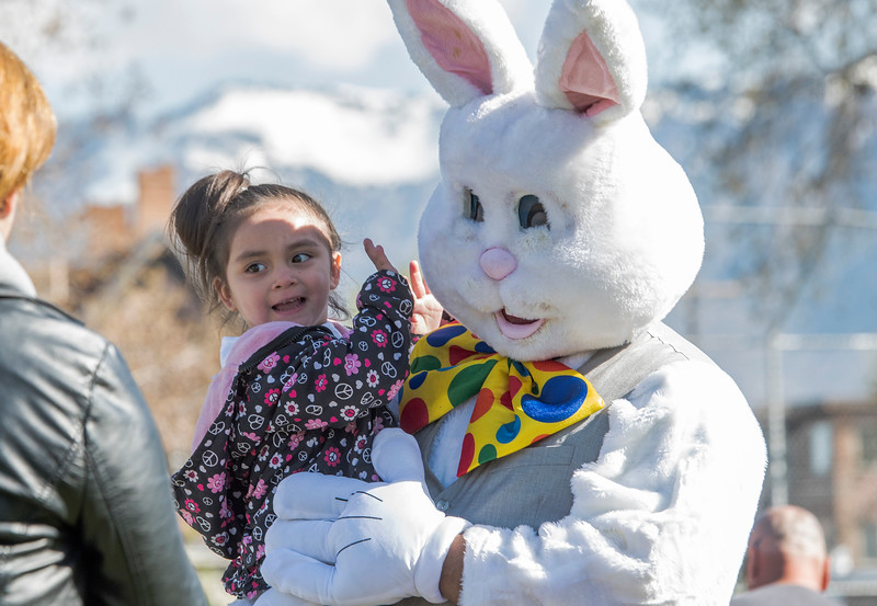 Aliyah Rodriguez excited to get her picture with Lavell Waiters dressed up as the Easter bunny. Ogden City Recreation placed over 15,000 eggs for 4 different age groups to find at the Marshall White Center in Ogden on Saturday April 15, 2017.