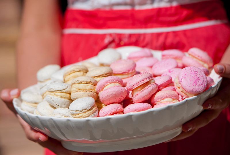 Jessica Orvis completes a order of 80 macarons. She said they have done orders up to 300 macarons in one order. All proceeds go towards setting up a medical clinic in Swaziland. In North Salt Lake on April 4, 2015.