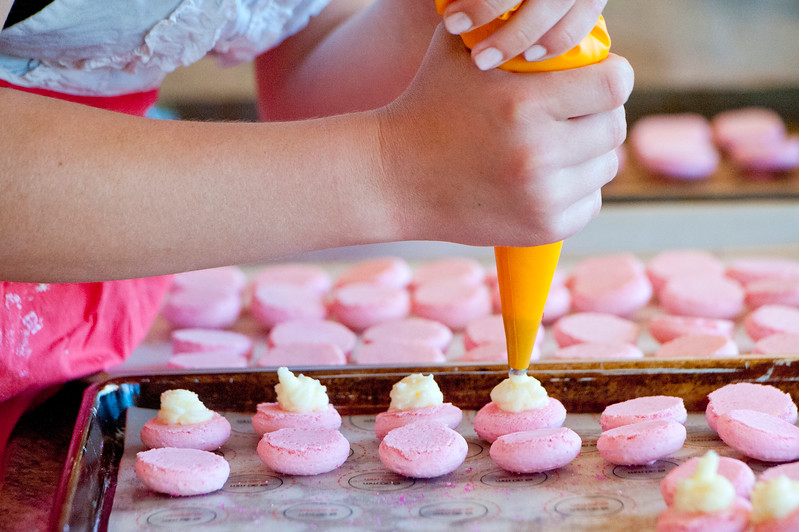 Jessica Orvis works on a order of 80 macarons. She is a High School Student who owns a small business selling macarons. All proceeds go towards setting up a medical clinic in Swaziland. In North Salt Lake on April 4, 2015.